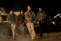 "AT-258   (from left) Face (Bradley Cooper), Murdock (Sharlto Copley), Hannibal (Liam Neeson) and B.A. (Quinton ""Rampage"" Jackson) race into action."
