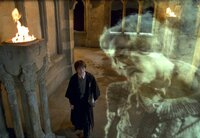 """(L-r) Harry Potter (DANIEL RADCLIFFE) encounters Nearly Headless Nick (JOHN CLEESE) in Warner Bros. Pictures' """"Harry Potter and the Chamber of Secrets."""""""