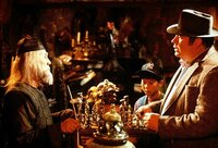 Rand Peltzer (Hoyt Axton, right) asks Grandfather (Keye Luke, left) about an unusual gift for his son, Billy.