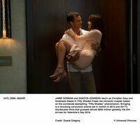Christian Grey (Jamie Dornan), Anastasia Steele (Dakota Johnson)