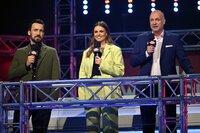 Die Moderatoren Jan Köppen (l.), Laura Wontorra und Frank Buschmann.