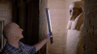Picture shows_Presenter Tony Robinson peers into the eyes of a Statue of the great ruler Sarenput II. This is the grandest tomb in the city of the dead in Aswan. Sarenput II was an Egyptian king or nomarch 4000 years ago