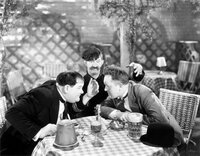 Oliver Hardy, James Finlayson, Stan Laurel.
