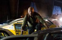 John McClane (Bruce Willis) prepares to take on a deadly adversary.