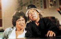 Wong Fei-Hung (Jacky Chan, l.); Beggar So (Yuen Hsiao Tien, r.)