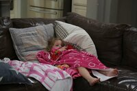 Olivia Busby laying on the couch.