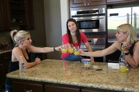 Danielle Busby, Crystal Mills, & Ashley Mowbray hanging out in her kitchen.