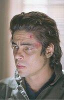 Aaron Hallam (Benicio Del Toro)