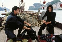Pierce Brosnan (James Bond), Michelle Yeoh (Wai Lin).