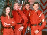 Diana (Jane Badler), John (Richard Herd), Brian (Peter Nelson) und Steven (Andrew Prine)