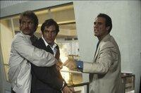 L-R: Braun (Guy De Saint Cyr), James Bond (Timothy Dalton), Franz Sanchez (Robert Davi)