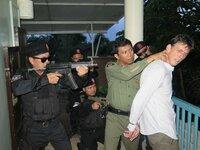 Philippines - Matthew Ashforde as Jimmy Kelly being arrested.