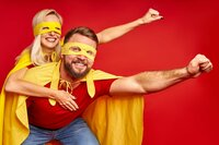 crazy couple imitate flight as superheroes wearing cloaks and masks