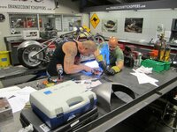 Paul Teutul Sr. and Mike Amerati weld together.
