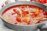 Chicken tikka masala in pan, closeup