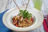Hakka Noodles is a popular Indo-Chinese recipes. Schezwan Noodles with vegetables in a plate. Top view.