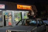 sitting on top of car: Louis Bloom (Jake Gyllenhaal)