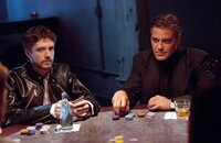 On the right: George Clooney as Danny Ocean.