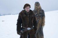 L-R: Han Solo (Alden Ehrenreich), Chewbacca (Joonas Suotamo)