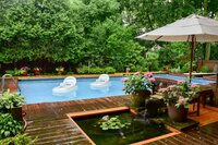 Backyard with pool after a afternoon downpour.