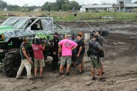 Mudders of Mayhem's Dancin' Bones catches big air on the muddy track.