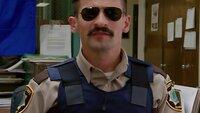 Deputy Travis Junior (Robert Ben Garant)