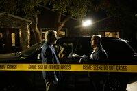 Investigators take in the crime scene.