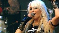 """""""Doro - The Queen Of Metal"""" zeigt die Hardrocksängerin Doro Pesch, die sich treu geblieben ist und es schafft, sich im rauen Metal-Genre zu behaupten, um es mit ihrer positiven und mitreißenden Art zu bereichern – und das seit fast 40 Jahren."""