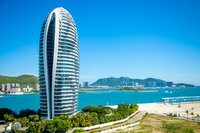 Sanya, Hainan Island, China - 22.06.2019: Close view of artificial Phoenix island with its famous skyscrappers in Sanya bay, Hainan Island in China