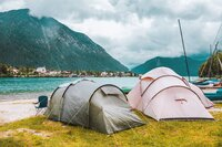 Camping tents on the coast of the alpine lake in Bayern (Bavaria), Germany.